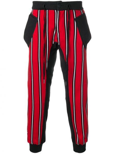 Спортивные черные зауженные брюки с карманами на шнурках Ktz