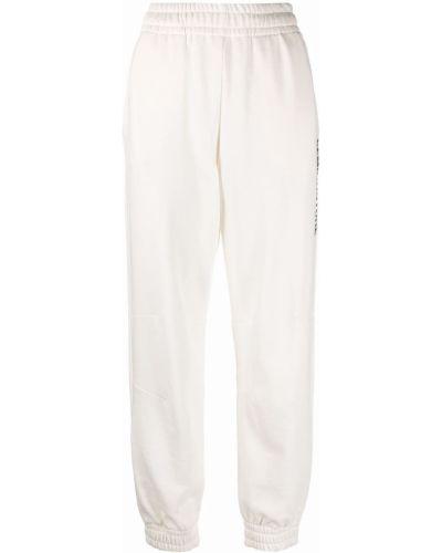 Зауженные спортивные брюки - белые Semicouture