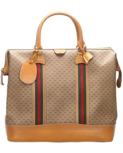 Золотистая парусиновая дорожная сумка на молнии с декоративной отделкой Gucci Pre-owned