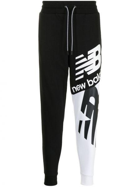 Черные хлопковые брюки New Balance