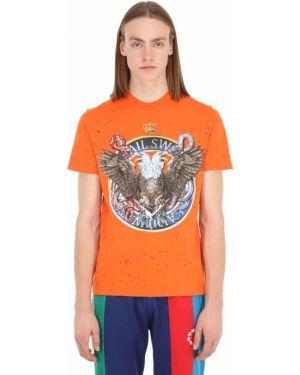 Pomarańczowy t-shirt bawełniany z printem Swatsky