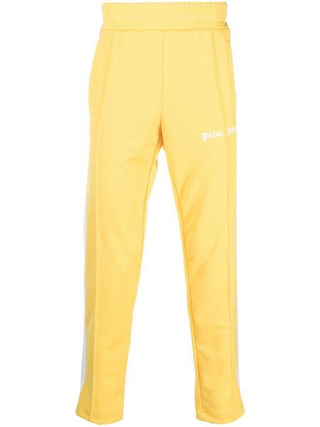 Żółty spodnie z kieszeniami w paski Palm Angels