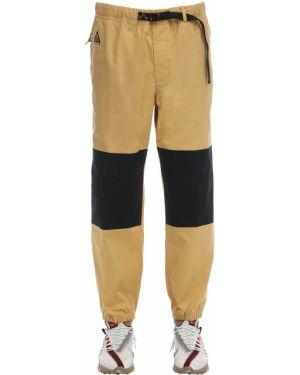 Spodnie bawełniane z paskiem Nike Acg