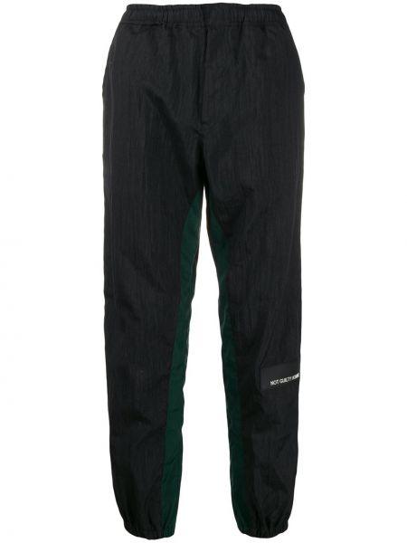 Спортивные зауженные брюки с поясом с манжетами бязевые Not Guilty Homme