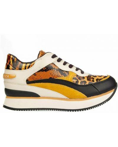 Pomarańczowe sneakersy na koturnie Apepazza