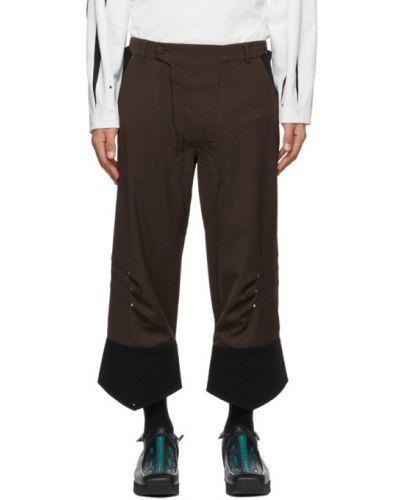 Czarne spodnie z paskiem zapinane na guziki Kiko Kostadinov