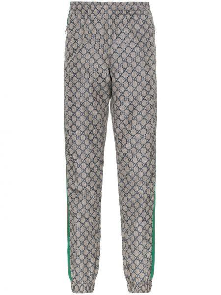 Zielone spodnie z printem Gucci