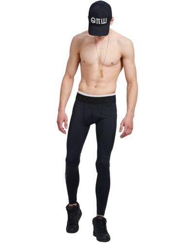 Czarne spodnie z printem Robert Kupisz