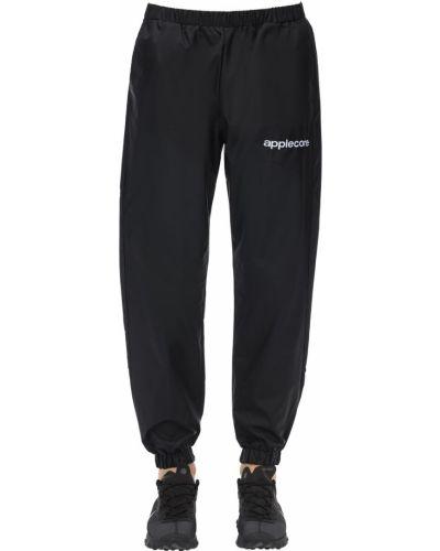 Czarne spodnie z printem Applecore