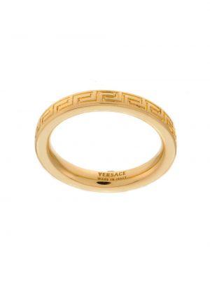 Золотистое кольцо золотое Versace