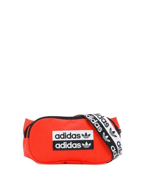 Pomarańczowy pasek z paskiem z printem Adidas