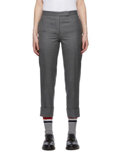 Wełniany spodni klasyczne spodnie z kieszeniami zapinane na guziki Thom Browne