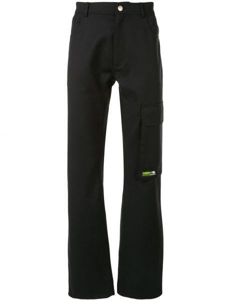 Czarne spodnie z paskiem z wiskozy Misbhv