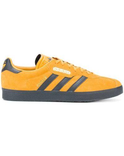 Оранжевые кроссовки в полоску Adidas Originals