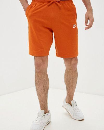 Оранжевые спортивные шорты Nike