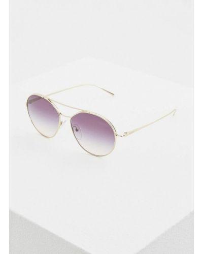 Солнцезащитные очки золотого цвета Prada