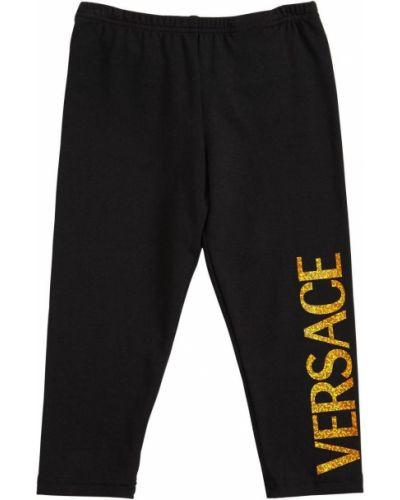 Czarne legginsy bawełniane z printem Versace