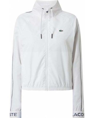Biała kurtka sportowa z raglanowymi rękawami Lacoste