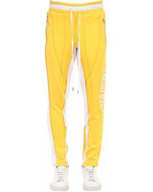 Żółte spodnie z haftem Renowned La