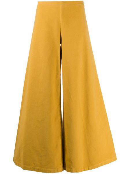 Брючные желтые расклешенные брюки стрейч Stefano Mortari