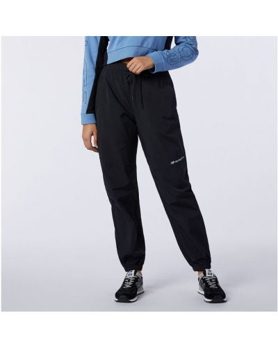 Свободная черная спортивная юбка свободного кроя New Balance