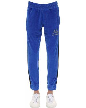 Niebieskie spodnie w paski Minimal