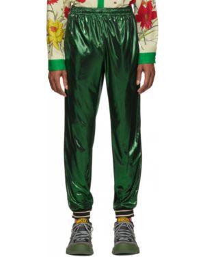 Spodnie na gumce z kieszeniami z mankietami Gucci