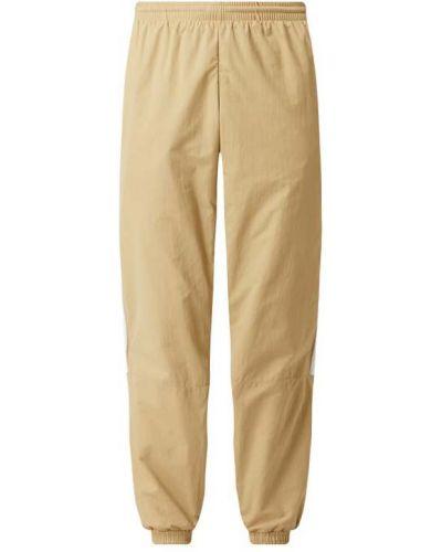 Beżowe spodnie Adidas Originals
