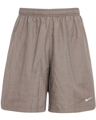 Зеленые шорты с карманами с вышивкой Nike