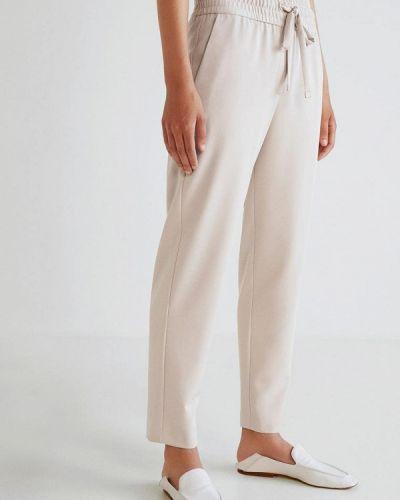 Бежевые брюки Mango