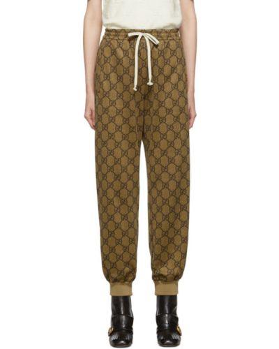 Biały bawełna spodnie z kieszeniami z mankietami Gucci