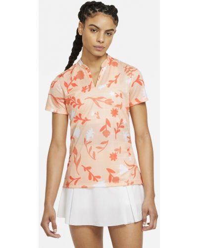 Pomarańczowy t-shirt z printem w kwiaty Nike