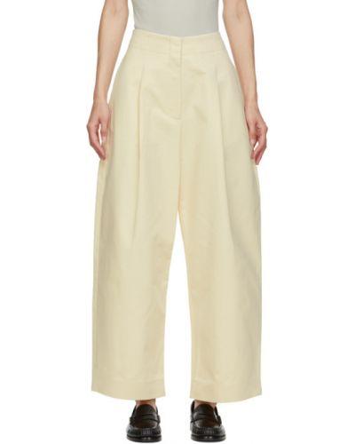 Брючные бежевые брюки с карманами свободного кроя Studio Nicholson