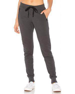 Spodnie na gumce sportowe z kieszeniami Alo