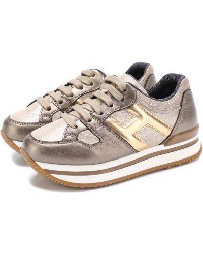 Кроссовки на платформе золотого цвета Hogan