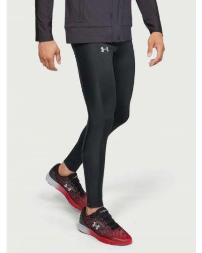 Czarne legginsy materiałowe koronkowe Under Armour