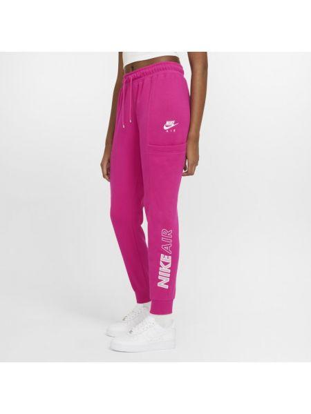 Różowe spodnie dzianinowe z haftem Nike
