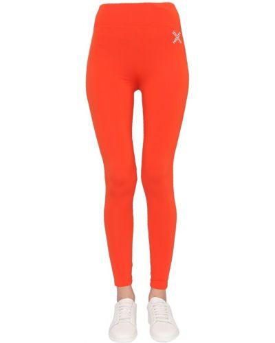 Pomarańczowe legginsy na co dzień z printem Kenzo