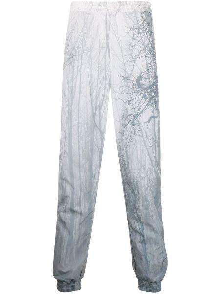 Białe spodnie z printem Astrid Andersen