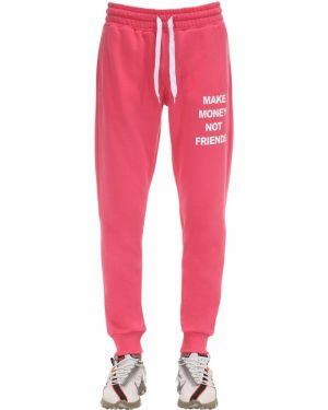 Prążkowane różowe joggery bawełniane Make Money Not Friends