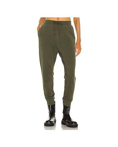 Хлопковые зеленые спортивные брюки с карманами Frame