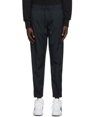 Nylon czarny spodnie sportowe z mankietami z haftem Aime Leon Dore