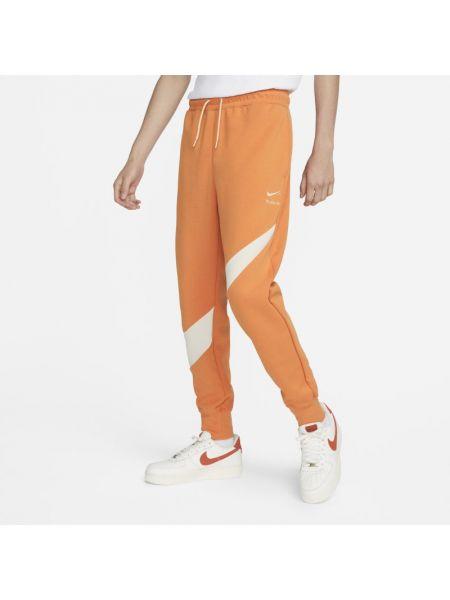 Joggery z haftem - pomarańczowe Nike