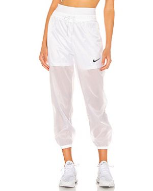 Хлопковые белые брюки на резинке Nike