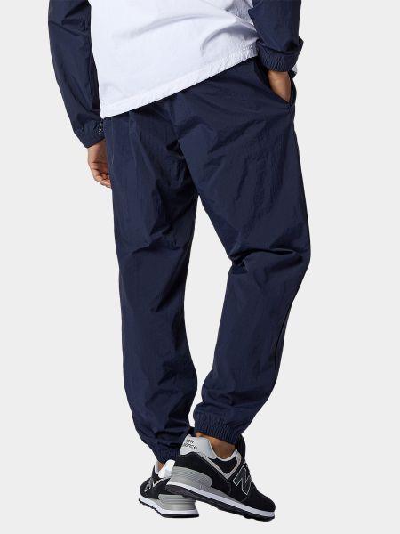 Синие спортивные брюки с карманами New Balance