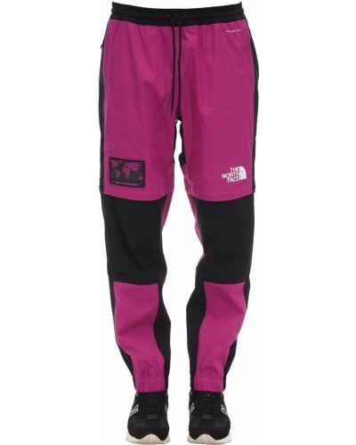 Spodnie na gumce z kieszeniami z nadrukiem The North Face