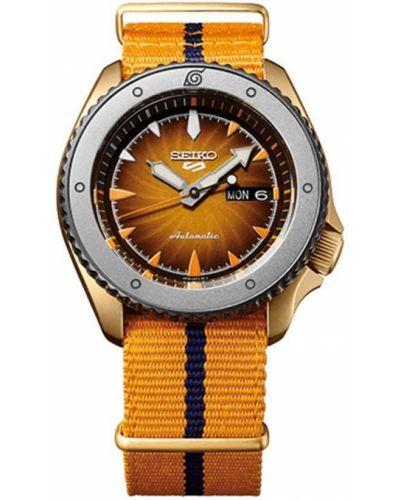 Żółty zegarek sportowy Seiko