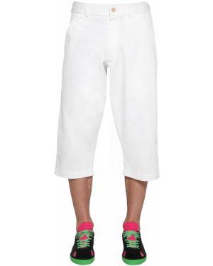 Białe spodnie bawełniane Comme Des Garcons Shirt