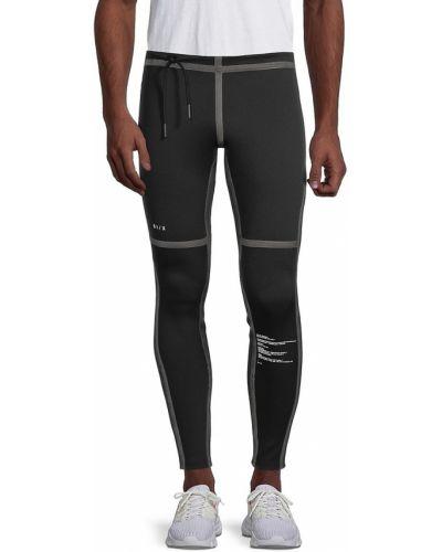 Czarne spodnie z nylonu Siki Im