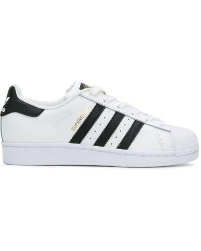 Кожаные кроссовки на каблуке в полоску Adidas